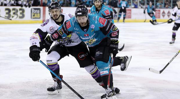 Belfast Giants forward Jonathan Ferland holds off Manchester Storm defenceman Dallas Ehrhardt (Darren Kidd/PressEye)