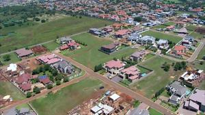 This aerial image taken from video provided by VNS24/7 on Thursday Feb. 14, 2013, shows the gated housing complex with the home of Olympic athlete Oscar Pistorius in Pretoria, South Africa. Olympic athlete Oscar Pistorius has been arrested in the shooting death of his girlfriend, police and the woman's talent agent said Thursday. (AP Photo/VNS24/7)