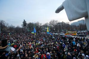 Demonstrators protest outside St. Michaels Golden-Domed Monastery in Kiev, Ukraine, Saturday, Nov. 30, 2013. Thousands of anti-government demonstrators in the Ukrainian capital have converged Saturday on a square outside a monastery where protesters driven away in a pre-dawn clash with police were taking shelter. Protesters are angered by President Viktor Yanukovych's refusal to sign an association agreement with the European Union and have vowed to continue demonstrating despite the harsh police response. (AP Photo/Sergei Grits)