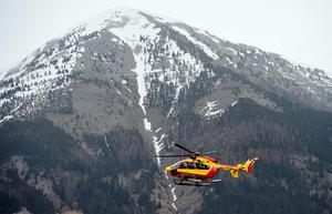 A helicopter of civil security services is seen in Seyne, south-eastern France, on March 24, 2015, near the site where a Germanwings Airbus A320 crashed in the French Alps.