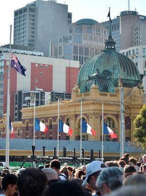 French flags fly at half-mast to remember the victims of the Paris terrorist attacks ahead of a vigil in Melbourne on 16 November 2015.  Islamic State jihadists claimed a series of coordinated attacks by gunmen and suicide bombers in Paris on November 13 that killed at least 129 people in scenes of carnage at a concert hall, restaurants and the national stadium.    AFP PHOTO / Paul CrockPAUL CROCK/AFP/Getty Images