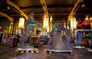 On the move: Some familiar figures, in the shape of magnificent Russian granite statues, were spotted getting ready to depart Belfast's Northern Whig! The 2 tonne statues have been an integral part of the venue's interior design for over 16 years, since they were rescued from the Communist Headquarters in Prague. Photo: Kevin Scott / Presseye