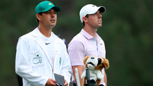 Contemplating: Rory McIlroy and caddie Harry Diamond wait to play on the 14th hole at Augusta yesterday