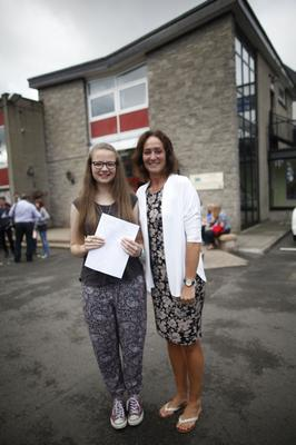 Imogen Forbes who received four A's and a B in As level pictured with principal Dr Michelle Rainey at Ballyclare High School. Pic by Peter Morrison