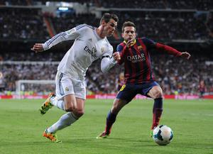Gareth Bale of Real Madrid takes on Jordi Alba of Barcelona during the La Liga match between Real Madrid CF and FC Barcelona at the Bernabeu on March 23, 2014 in Madrid, Spain.  (Photo by Denis Doyle/Getty Images)