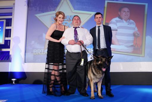 Sunday Life Unsung Hero Category Winner 2014: Brian McDonagh pictured with Sunday Life editor Martin Breen and The Fall star Bronagh Waugh. Kelvin Boyes/Press Eye.