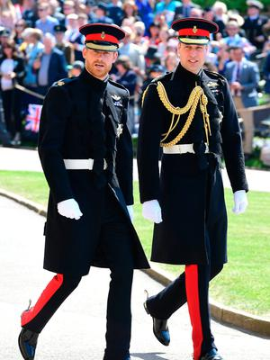 Prince Harry (left) and The Duke of Cambridge (right) arrive at St George's Chapel at Windsor Castle for the wedding of Meghan Markle and Prince Harry. Ian West/PA Wire