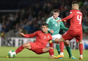 Oliver Norwood and Ronaldo during this evenings 2014 World Cup qualifier between Northern Ireland and Portugal at Windsor park, Belfast. Picture Charles McQuillan/Pacemaker.