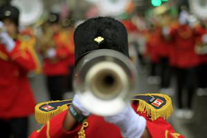 A Canadian marching band joins revellers during the St Patrick's day parade through Dublin city centre on St Patrick's day. PRESS ASSOCIATION Photo. Picture date: Sunday March 17, 2013. Photo credit should read: Julien Behal/PA Wire