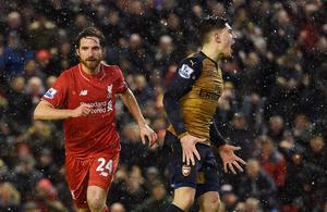 Liverpool's Welsh midfielder Joe Allen (L) celebrates after scoring during the English Premier League football match between Liverpool and Arsenal at Anfield stadium in Liverpool, north-west England on January 13, 2016. AFP PHOTO / PAUL ELLIS RESTRICTED TO EDITORIAL USE. NO USE WITH UNAUTHORIZED AUDIO, VIDEO, DATA, FIXTURE LISTS, CLUB/LEAGUE LOGOS OR 'LIVE' SERVICES. ONLINE IN-MATCH USE LIMITED TO 75 IMAGES, NO VIDEO EMULATION. NO USE IN BETTING, GAMES OR SINGLE CLUB/LEAGUE/PLAYER PUBLICATIONS.PAUL ELLIS/AFP/Getty Images