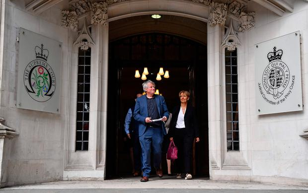 """The Northern Ireland Human Rights Commission's (NIHRC) Chief Commissioner, Les Allamby (C), leaves the Supreme Court in London on June 7, 2018 to address members of the media. Britain's Supreme Court on Thursday said it could not rule on an appeal against Northern Ireland's strict abortion laws, but that it would have declared them incompatible with human rights laws otherwise. By a majority decision, the justices said that the Northern Ireland Human Rights Commission (NIHRC), which brought the appeal, did not have the power to """"institute abstract proceedings of this nature"""". / AFP PHOTO / Ben STANSALLBEN STANSALL/AFP/Getty Images"""