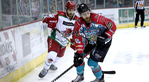 Belfast Giants winger Ciaran Long escapes the clutches of Cardiff Devils defenceman Gleason Fournier during Saturday night's game at the SSE Arena (William Cherry/Presseye)