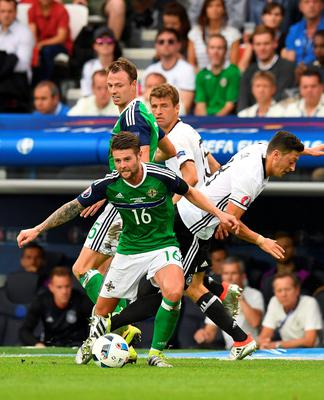 PARIS, FRANCE - JUNE 21: Oliver Norwood (L) of Northern Ireland and Mesut Ozil (R) of Germany during the UEFA EURO 2016 Group C match between Northern Ireland and Germany at Parc des Princes on June 21, 2016 in Paris, France. (Photo by Charles McQuillan/Getty Images)