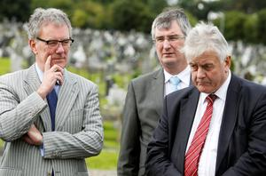 (Left - right) Ulster Unionist Party leader Mike Nesbitt (left) with Tom Elliott MLA and Jim Nicholson MEP pay their tributes at the graves of seven Polish airmen, killed during the Second World War, at Milltown Cemetery, west Belfast. Photo: Brian Lawless/PA
