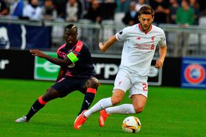 Bordeaux's French Senegalese forward Henri Saivet (L) vies with Liverpool's midfielder Adam Lallana (R) during the UEFA Europa League Group B football match Bordeaux vs Liverpool on September 17, 2015 at the Matmut Atlantique stadium in Bordeaux. AFP PHOTO / NICOLAS TUCATNICOLAS TUCAT/AFP/Getty Images