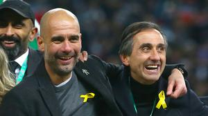 Pep Guardiola (left) will write to the FA explaining his reasons for wearing a yellow ribbon