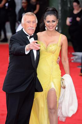 Bruce Forsyth and wife Winnie arriving for the 2013 Arqiva British Academy Television Awards at the Royal Festival Hall, London. PRESS ASSOCIATION Photo. Picture date: Sunday May 12, 2013. See PA story SHOWBIZ Bafta. Photo credit should read: Dominic Lipinski/PA Wire