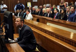 Oscar Pistorius sits in the dock prior to the start of his trial at the high court in Pretoria, South Africa, Monday, March 3, 2014. Pistorius is charged with murder with premeditation in the shooting death of girlfriend Reeva Steenkamp in the pre-dawn hours of Valentine's Day 2013. (AP Photo/Themba Hadebe, ool)