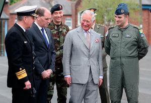 The Prince of Wales chats with Vice Admiral Mark Mellett and Junior defence Minister Paul Keogh visits The Irish Defence Forces / UN Training School at Curragh, in the Republic of Ireland. PRESS ASSOCIATION Photo. Picture date: Thursday May 11, 2017. The Prince of Wales and the Duchess of Cornwall are on a three day visit to Ireland. See PA story ROYAL Ireland. Photo credit should read: Niall Carson/PA Wire