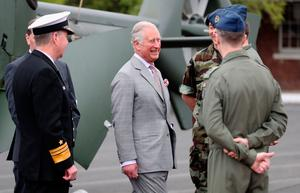 The Prince of Wales  is shown the shares a joke with Air Corps Pilots  as he visits The Irish Defence Forces / UN Training School at Curragh, in the Republic of Ireland. PRESS ASSOCIATION Photo. Picture date: Thursday May 11, 2017. The Prince of Wales and the Duchess of Cornwall are on a three day visit to Ireland. See PA story ROYAL Ireland. Photo credit should read: Niall Carson/PA Wire