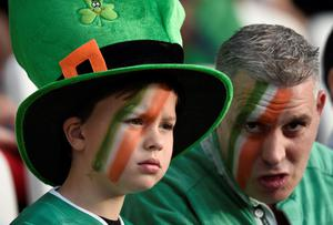 Irish fans pose before a Pool D match of the 2015 Rugby World Cup between Ireland and Italy at the Olympic Stadium, east London, on October 4, 2015. AFP PHOTO / MARTIN BUREAU RESTRICTED TO EDITORIAL USE, NO USE IN LIVE MATCH TRACKING SERVICES, TO BE USED AS NON-SEQUENTIAL STILLSMARTIN BUREAU/AFP/Getty Images