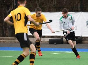 Sullivan Upper's Djay Erskine, right, in action against RBAI during their Burney Cup Semi-Final at Instonians Hockey Club.  Photo by Peter Morrison