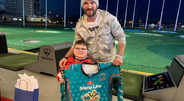 Ethan McClean (11), from Ballymena, presents Washington Capitals captain Alexander Ovechkin with a Belfast Giants jersey