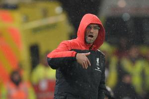 Liverpool's German manager Jurgen Klopp gestures from the touchline during the English League Cup semi-final first leg football match at Britannia Stadium in Stoke-on-Trent, central England, on January 5, 2015.  AFP/Getty Images