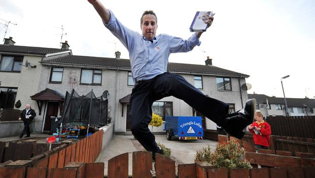Ian Paisley hurdles a fence during canvassing for 2010 election. Pic Charles McQuillan Pacemaker