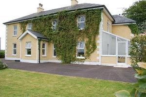 No 8: Glenvar House Carra  Newtownbutler Fermanagh Offers from £1,250,000 Magnificent Victorian country house set in beautiful mature grounds of approximately five acres. Built in 1855 in a stuccoed neo-classical style and featured in 'The Linen Houses of The Lagan Valley' book. Sympathetically refurbished in 2004 and tastefully presented throughout, retaining much of its original character  Bright and spacious accommodation with features including sliding sash windows with original panelled shutters, beautiful Victorian fireplaces, cornicing and decorative friezes and original stripped floorboards
