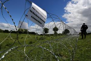 Razor wire which has been laid in fields  near the Lough Erne resort in County Fermanagh the venue for next weeks G8 Summit. PRESS ASSOCIATION Photo. Picture date: Wednesday June 12, 2013. See PA story ULSTER G8. Photo credit should read: Paul Faith/PA Wire
