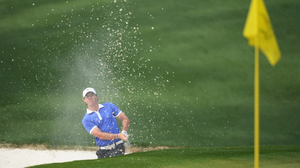 Rory McIlroy hits out of a bunker on the 10th hole during the first round of the 2013 Masters at Augusta National Golf Club