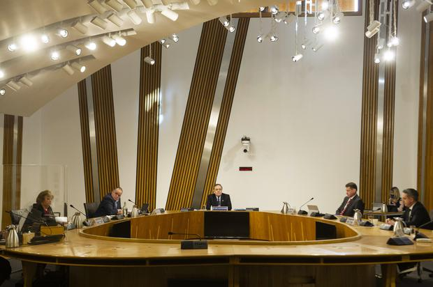 Mr Salmond, centre, is appearing in person before the Holyrood committee (Andy Buchanan/PA)