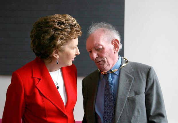 Brian Friel with President Mary McAleese as he received the Aosdana's highest honour. (Julien Behal/PA Wire)