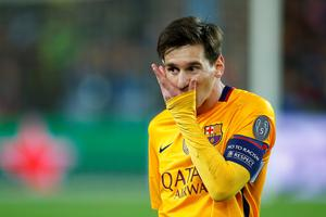 Barcelona's Lionel Messi leaves the pitch at the end of a Champions League quarter-final, first leg soccer match between FC Barcelona and Atletico Madrid at the Camp Nou stadium in Barcelona, Spain, Tuesday April 5, 2016. (AP Photo/Manu Fernandez)