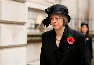 Home Secretary Theresa May, walks through Downing Street on her way to the annual Remembrance Sunday service at the Cenotaph memorial in Whitehall. Chris Radburn/PA Wire.