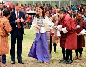 THIMPHU, BHUTAN - APRIL 14:  Prince William, Duke of Cambridge looks on as Catherine, Duchess of Cambridge fires an arrow during an Bhutanese archery demonstration on the first day of a two day visit to Bhutan on the 14th April 2016 in Paro, Bhutan. The Royal couple are visiting Bhutan as part of a week long visit to India and Bhutan that has taken in cities such as Mumbai, Delhi, Kaziranga, Bhutan and Agra.  (Photo by Chris Jackson/Getty Images)