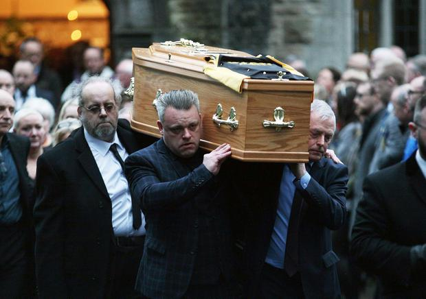 Mandatory Credit - Picture by Freddie Parkinson © Tuesday 7 January 2020 Funeral of Cillian Draine (11) died suddenly at home. Beloved son of Mary and Mick, brother of Fiontan and Michael. Service was at St Therese of Lisieux Church, 71 Somerton Road, Belfast. CillianÕs father Mick carries his sonÕs coffin with his Star ABC top.