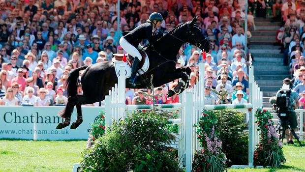 High hopes: Jonelle Price on Classic Moet in the show jumping round during the Mitsubishi Motors Badminton Horse Trials