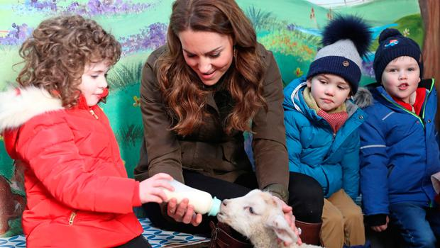 NEWTOWNARDS, NORTHERN IRELAND - FEBRUARY 12: Catherine, Duchess of Cambridge helps feed a Lamb with children from two local nurseries during a visit to The Ark Open Farm on February 12, 2020 in Newtownards, Northern Ireland. This visit is part of her Early Years Foundation Survey. Five Big Questions, aiming to spark a UK-wide conversation on early childhood. (Photo by Chris Jackson/Getty Images)
