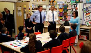 President Barack Obama and Prime Minister David Cameron watch as students work on a school project about the G8 summit during a visit to the Enniskillen Integrated Primary School in Enniskillen, Northern Ireland ahead of the G8 summit. PRESS ASSOCIATION Photo. Picture date: Monday June 17, 2013. See PA story POLITICS G8. Photo credit should read: Matt Dunham/PA Wire