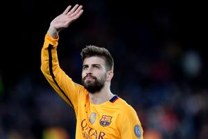 Barcelona's defender Gerard Pique waves during the UEFA Champions League quarter finals first leg football match FC Barcelona vs Atletico de Madrid at the Camp Nou stadium in Barcelona on April 5, 2016. / AFP PHOTO / JOSEP LAGOJOSEP LAGO/AFP/Getty Images