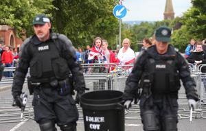 Picture - Kevin Scott / Presseye  Belfast - Northern Ireland - Monday 13th July 2015 -  Woodvale Parade   Pictured is police riot officers dealing with violence at the Orange order parade as it reaches its stopping point on the Woodvale road in North Belfast, Northern Ireland.    Picture by Kevin Scott  / Presseye.