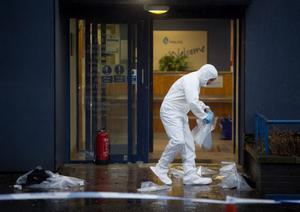 Forensic officers at the scene at a police station on Montrose Street in Clydebank, Scotland, where a woman apparently set herself on fire. PRESS ASSOCIATION Photo. Picture date: Wednesday January 7, 2015. The incident happened in a public area of the police office and she is believed to have suffered burns and was taken to Glasgow Royal Infirmary by ambulance. See PA story POLICE Woman. Photo credit should read: Danny Lawson/PA Wire