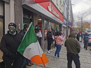 Saoradh target Santander In coordinated protests - Saoradh members based in Derry, Newry and Belfast carried out a series of co-ordinated protests in a day of direct action targeted at local branches of Santander today [October 17].