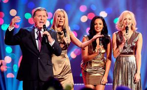 Sir Terry Wogan with (left to right) Tess Daly, Alesha Dixon and Fearne Cotton during the BBC Children In Need Appeal 2011