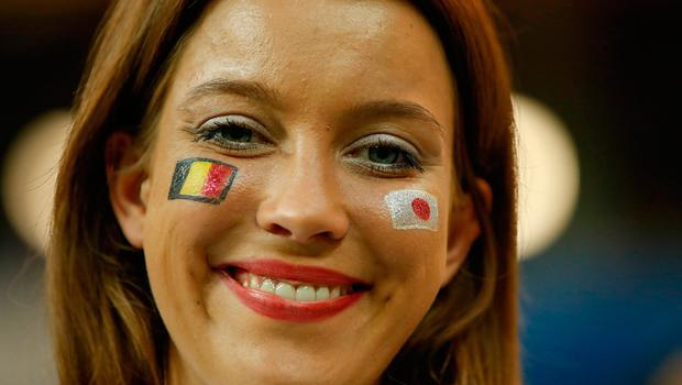 A football fan poses before the start of the Russia 2018 World Cup round of 16 football match between Belgium and Japan at the Rostov Arena in Rostov-On-Don on July 2, 2018.