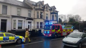 Police and firefighters at the scene of a fire at Galgorm Road, Ballymena, on Saturday January 2, 2016. Picture North East News