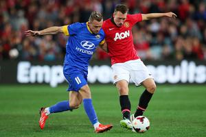 SYDNEY, AUSTRALIA - JULY 20: Besart Berisha of the All-Stars competes with Phil Jones of Manchester United during the match between the A-League All-Stars and Manchester United at ANZ Stadium on July 20, 2013 in Sydney, Australia.  (Photo by Brendon Thorne/Getty Images)