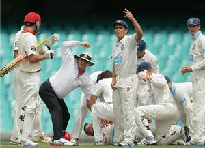Players call for medical help after Hughes collapses